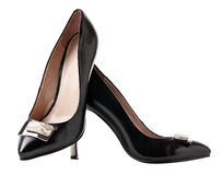 Pair of black female shoes over white Royalty Free Stock Photo