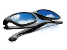 A pair of black glasses with blue sky Stock Photos