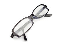 Pair of black glasses isolated Stock Photos
