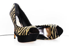 Pair of black-golden shoes Royalty Free Stock Image