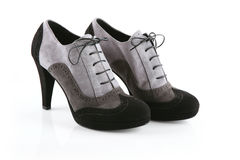 Pair of black and gray stiletto shoes Royalty Free Stock Images