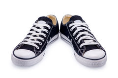 A pair of black gumshoes with shoelace Stock Image