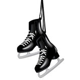 Pair of black ice skates on white. Pair of black ice skates hanging isolated on white Stock Photo
