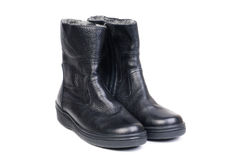 Pair of black leather boots for men on a white Stock Photo