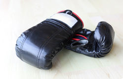 Pair of black leather boxing gloves Stock Images