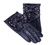 Pair of black leather gloves. With bow isolated on white Stock Images