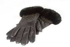 Pair of black leather gloves. With fur (on white Stock Photography