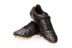 Pair of black leather soccer shoes Stock Images