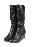 A pair of black leather women`s boots. Isolated on white background royalty free stock image