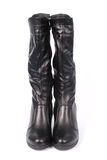 A pair of black leather women`s boots. Isolated on white background stock image