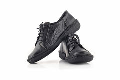Pair of black leather women's shoes over white Royalty Free Stock Image