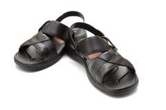 Pair of black leisure sandal on white Stock Image