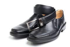 Pair black man's shoe and a belt Royalty Free Stock Photo