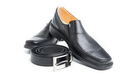 Pair black man's shoe and a belt. On white background stock photos