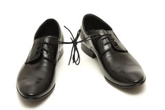Pair of black man shoes tied together on white Stock Images