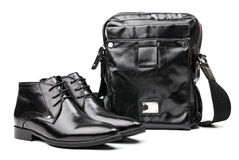 Pair of black men boots and messenger bag Stock Photos