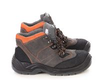 Pair of black and orange men boots. Royalty Free Stock Photos