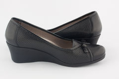 A pair of black platform shoes Stock Photography