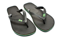 Pair of black rubber flip flop sandals. On white stock photos