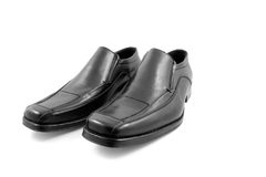 Pair of black shiny men shoes. Pair of black shiny business shoes for men, over white background Stock Image
