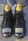 Pair of black shoes as symbol of gun violence Royalty Free Stock Image