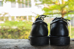 A pair of black shoes Stock Photos