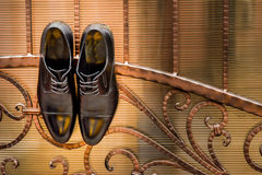 Pair of black shoes hanged. On a fence Royalty Free Stock Images