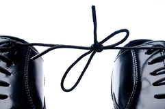 A pair of black shoes tied together Royalty Free Stock Photography