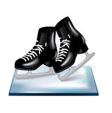 Pair of black skates on ice Royalty Free Stock Photo