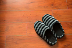 Pair of black slippers Stock Image