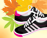 Pair of black sneakers on the autumn background. Illustration Stock Images