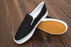Pair of black sneakers Stock Photos