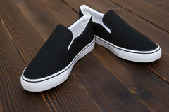 Pair of black sneakers Stock Photography