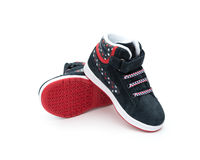 Pair of black stylish shoes for kid on white Stock Photos
