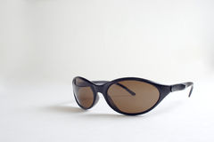 A pair of black sunglasses Stock Images