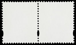 Pair of Blank Postage Stamps. Isolated on Black Background Stock Photo
