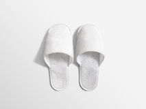Pair of blank soft white home slippers, design mockup. House plain flops mock up template top view. Clear warm domestic sandal. Bed shoes accessory footwear Royalty Free Stock Photo