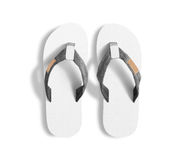 Pair of blank white slippers, design mockup, clipping path. Royalty Free Stock Photo