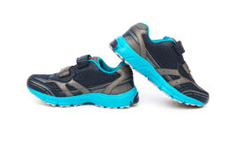 Pair of blue and black sporty shoes for kid on white Stock Photo