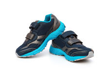 Pair of blue and black sporty shoes for kid on white Stock Photography