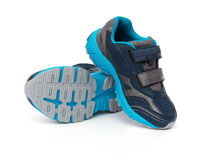 Pair of blue and black sporty shoes for kid on white Royalty Free Stock Image