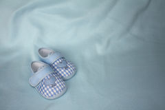 A pair of blue checkered baby booties Royalty Free Stock Images