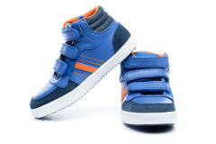 Pair of blue children sneakers Royalty Free Stock Photography