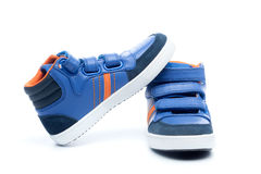 Pair of blue children sneakers Stock Photos