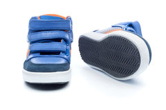 Pair of blue children sneakers Stock Photos