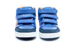Pair of blue children sneakers Royalty Free Stock Photos