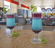 Pair of blue cocktail dirnks on a bar Royalty Free Stock Photos