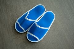 A pair of blue disposable slippers with soft foam texture for in stock image