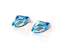 Pair of blue earrings stock photography