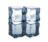 Pair of blue ice cubes with reflection Royalty Free Stock Photography